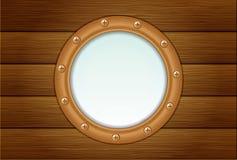 Hublot sur le mur en bois Photographie stock libre de droits