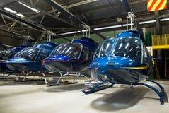 Hubschrauber-Hangar, voll von Bel 407 Stockbild