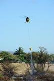 Hubschrauber- und Pinselfeuer Stockfotografie