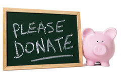 Hucha con el mensaje de la caridad Fotos de archivo libres de regalías