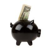 Hucha negra con un dólar imagenes de archivo