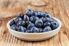 Huckleberries super food in a white china dish Royalty Free Stock Photos