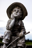 Huckleberry Huck Finn. A statue that looks to resemble Huckleberry Huck Finn Royalty Free Stock Image