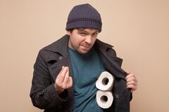 Huckster man holding several roll of toilet paper. Do you want to buy it