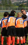 Huddle. Coach doing a huddle with his team Royalty Free Stock Photo