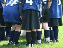 The Huddle. Young soccer players are in a huddle, planning their winning stradegy stock photography