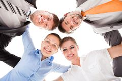 Huddle Of Happy Businesspeople. Low Angle View Of Businesspeople Making Huddle royalty free stock image