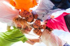 A huddle of school kids looking down at camera, stock photography