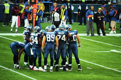The Huddle. The Seattle Seahawks huddle together and plan their next play royalty free stock images