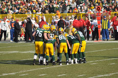 Huddling dos empacotador do Green Bay Foto de Stock