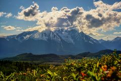 Hudson Bay Mountain - Spring Mood. A beautiful view of Hudson Bay Mountain close to Smithers in the Bulkley Valley BC on Highway 16 which is also known as stock photos