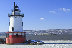 Hudson Lighthouse and Barge. A barge head sup the icy Hudson River behind the Sleepy Hollow Lighthouse Stock Images