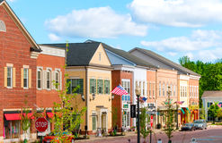 Hudson retail district. HUDSON, OH - JUNE 14, 2014: Hudson's new retail district, First and Main, was given a retro look to match the quaint charm of the village royalty free stock image