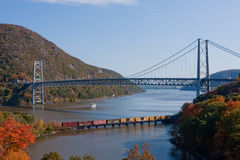The Hudson River. The Bear Mountain Bridge and a freight train traveling down the Hudson River Royalty Free Stock Image