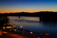 Hudson River at dusk in Hudson with lighthouse and boats Stock Images