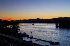 Hudson River at dusk in Hudson with lighthouse and boats Royalty Free Stock Photo