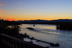 Hudson River at dusk in Hudson with lighthouse and boats Royalty Free Stock Photos