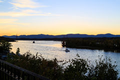 Hudson River at dusk in Hudson with lighthouse and boats Royalty Free Stock Images