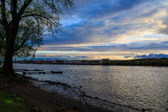 Hudson River view of Albany docks from Rennselaer NY at dusk Royalty Free Stock Photo