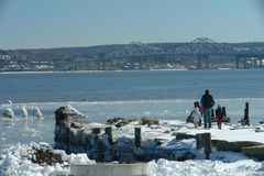 Hudson River View at Tappan Zee. A family out on a sunny winter day, enjoying the view across the Hudson River and the Tappan Zee Bridge in New York State Royalty Free Stock Photo