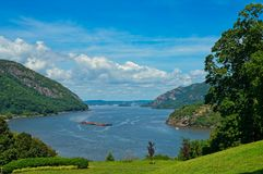 Hudson River vista from West Point. A barge moves down the Hudson River at West Point, New York royalty free stock images