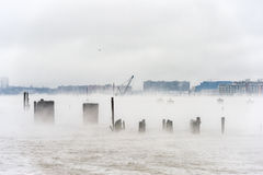 Hudson river in Winter with Misty Edgewater Cityscape in Background. Stock Photo