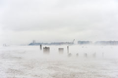 Hudson river in Winter with Misty Edgewater Cityscape in Background. Stock Photos