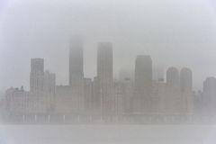 Hudson river in Winter with Misty New York Cityscape in Background. Stock Photography