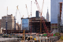 Hudson Yards Redevelopment, New York. The Hudson Yard Redevelopment Project carries on next to trains waiting in the existing West Side Yard.  The Empire State Royalty Free Stock Photography