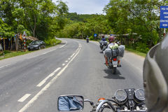 Hue Easy Riders, Vietnam. Tourists on motorbikes with easy riders who bring them by motorbike from one destination to another in Vietnam. The easy riders are Royalty Free Stock Photo