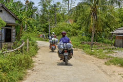 Hue Easy Riders, Vietnam. Tourists on motorbikes with easy riders who bring them by motorbike from one destination to another in Vietnam. The easy riders are Royalty Free Stock Image