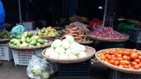 Hue market. Fruit lady market selling dragon fruit Royalty Free Stock Photo