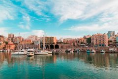 Hue shifted photo of heraklion city old port panoramic view sea sky boats floating and building vintage look. Hue shifted photo of heraklion city old port royalty free stock photo