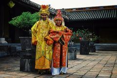 young wedding couple in a traditional setting waiting for relatives to come royalty free stock photo