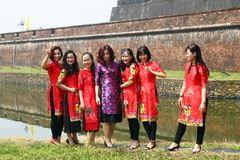 Hue, Vietnam - February 10, 2018: Group of Vietnamese women in the traditional dresses before celebration of Tet stock images