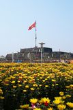 Hue, Vietnam - February 10, 2018: Hue Imperial City. View on Citadel with Vietnamese flag and yellow flowers of chrysanthemums royalty free stock images