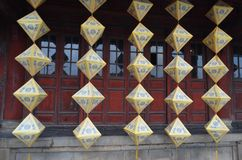 Hue, Vietnam-The Imperial City-hanging lanterns in front of carved red doors stock images
