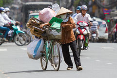 HUE, VIETNAM - JULY 25. Vietnamese woman packed her possesions o Royalty Free Stock Photo