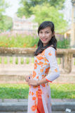 Hue, Vietnam Mar 15:: Vietnamese girl in national dress at The Royalty Free Stock Photos