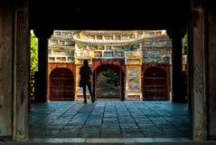 Hue, Vietnam - November 11, 2015: Atmospheric corridor with tourist standing in the shade. Hue, Vietnam - November 11, 2015: Atmospheric corridor through a Royalty Free Stock Photography