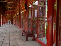 Hue, Vietnam - September 13 2017: Beautiful red wooden hall with golden ornate details in Hue citadel, Vietnam, Asia Royalty Free Stock Photography