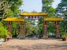 Hue, Vietnam - September 13 2017: Old enter of an arch with a yellow roof, in Hue Vietnam.  Stock Photography