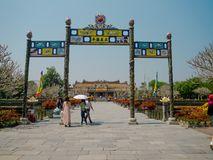 Hue, Vietnam - September 13 2017: Unidentified people walking at the enter of an arch in Imperial City Hue Vietnam.  Stock Photos