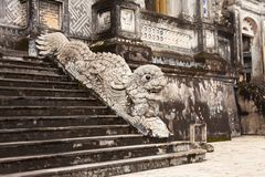 Hue, Vietnam. Stone dragon decoration. Stone dragon carved as stair handrail on the Thien Dinh palace entrance at Royal Khai Dinh Tomb complex Royalty Free Stock Image