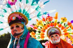 Huehues Mexico, Carnival scene, dancer wearing a traditional mexican folk costume and mask rich in color. Huehues Mexico Carnival scene, dancer wearing a Royalty Free Stock Photos