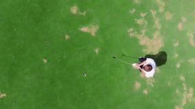 Huelga acertada del golf en una visión desde arriba metrajes