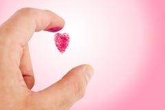 Huella digital en forma de corazón Fotos de archivo libres de regalías