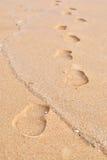 Huella en una arena Imagen de archivo