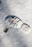 Huella/roca en nieve Fotografía de archivo libre de regalías
