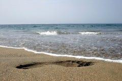 Huella y agua Imagen de archivo libre de regalías